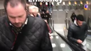 Efficiency man runs up down escalator