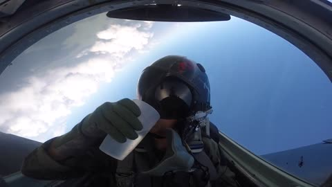 Pilot manages to drink water from cup while flying upside down