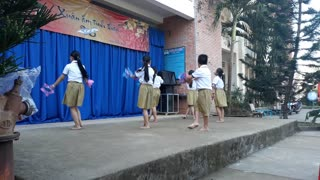 Elementary school students dance
