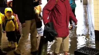 People walking through flooded subway underground tunnel - Video