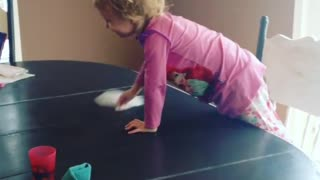 Sweet little girl loves helping mom clean the house