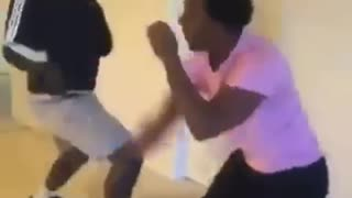 Two black guys one adidas jacket one ping shirt fighting in living room - Video