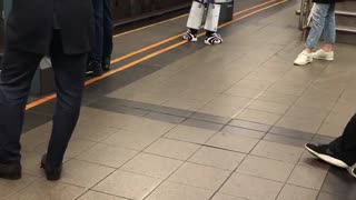 Robot transformers costume made out of beer boxes subway platform