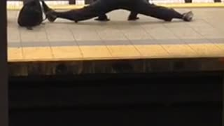 Security jackets does splits in subway terminal - Video