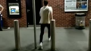 Guy in white shirt back flip off brick wall