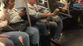 Man red ear phones jumping in subway train