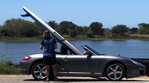 Surf board in grey silver convertible car