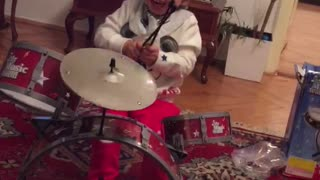 the baby plays drums  - Video