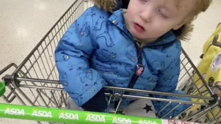 Kid Can't Stay Awake in Shopping Cart