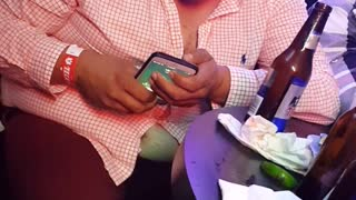 Overly Drunk Man Struggles with Phone - Video