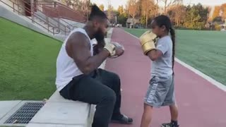 Dad teaches his daughter how to fight