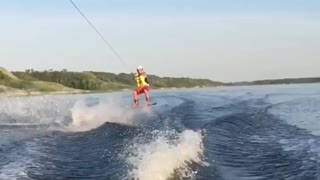 Guy slow mo red shorts wake board fail