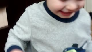 adorable toddler laughing at mommy's reaction