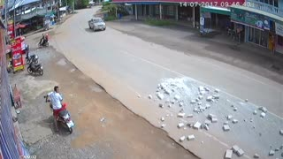 Lucky Motorcyclists Escape Bricks Falling from Truck - Video