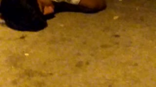 Guy white shirt laying on ground drunk - Video