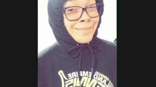 "College student girl in hoodie and glasses, makes weird faces to ""let's get it on"" song"