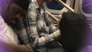 Man in white shirt sleeps on man with blue flannel  - Video