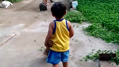 toddler helping family do the cleaning