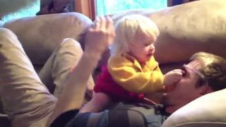 Adorable Baby Protects Dad In Pillow Fight - Video