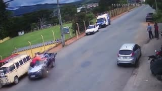 Lucky Motorcyclist Survives Horrific Crash - Video
