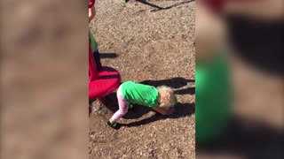 Dizzy Toddler Goes For A Spin At The Playground - Video