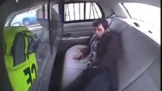 How not to escape from the back of a cop car