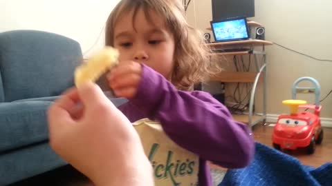 4 yrs old's first time eating salt and vinegar chips.