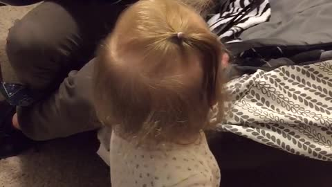 Baby Avery dances to Daddy strumming the guitar
