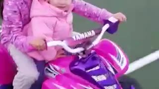 Two girls motorcycle stuck on net - Video