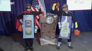 "Chicago Mayor Lori Lightfoot enters a news conference dressed as ""Corona Destroyer"""