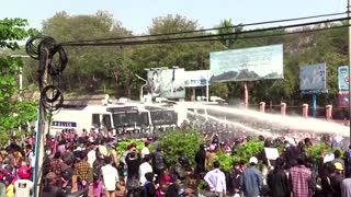 Myanmar police turn water cannon on protesters