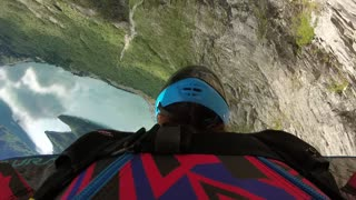 Wingsuit Base Jumper Collects Some Branches on His Run