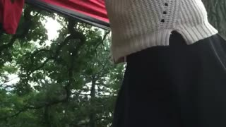 Black skirt tries to get hammock falls - Video