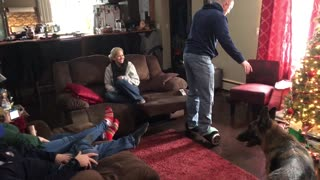 Blue hoodie dad falls off segway into christmas tree