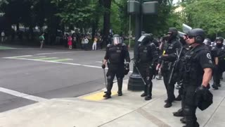 Portland protest turns violent as police in riot gear arrive