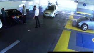Car Parking Garage Fight Ends in Knock Out - Video