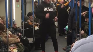 Guy black sweater jacket dancing subway train