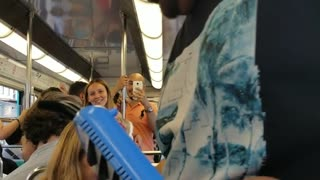 "Man plays ""despacito"" with a melodica on a bus"