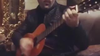 Guy playing guitar and singing Ebi's song - Video