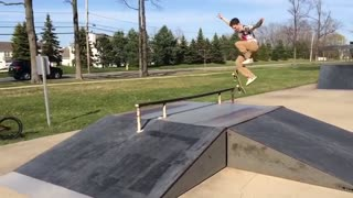 Skateboard misses rail kid hits side - Video