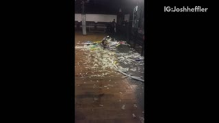Girl sliding into a pile of trash - Video