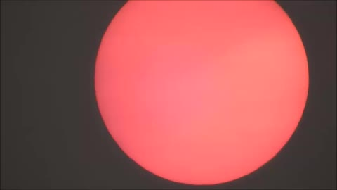 Gorgeous pink sunrise due to forest fire haze