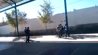 School kids tire throw head duck