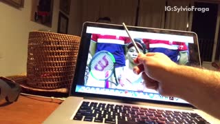 Cat reaches over laptop for pen - Video