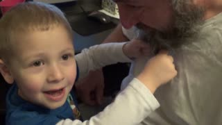 Little Boy Pretends To Milk His Dad's Beard - Video