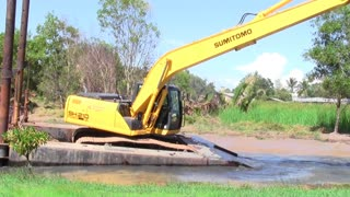 Bulldozer cleaning river