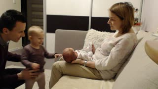 Baby girl showing newborn sister some love! - Video