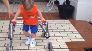 Boy with Down Syndrome takes his first steps