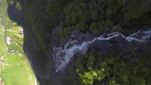 This Footage Of Speedflying Over A Waterfall Will Give You An Adrenaline Rush