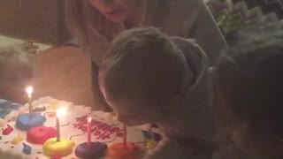 Little Boy Eats Fire Off Cake - Video